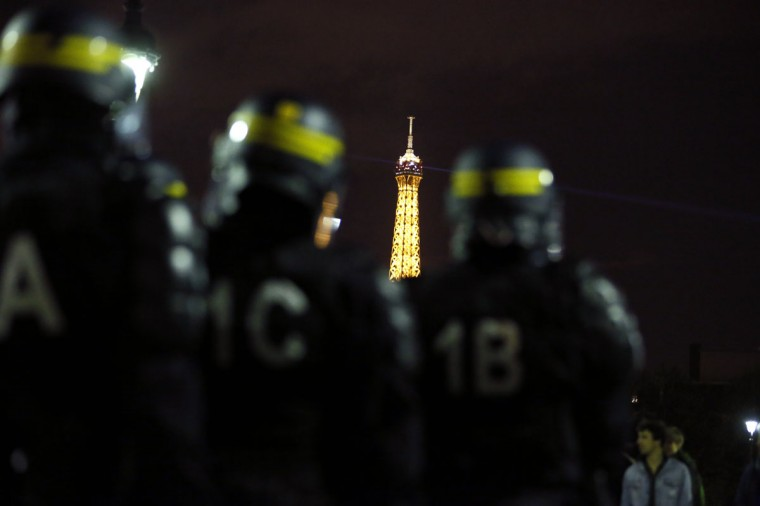 "The Eiffel Tower is seen in the distance as French riot police stand by during a demonstration by supporters of the anti-gay marriage movement ""La Manif Pour Tous"" (Demonstration for all!) in Paris on April 18, 2013. The final vote on France's landmark bill allowing gay marriage has been fast-tracked to next week. The bill has proved hugely controversial in a country that is officially secular but predominantly Catholic, mobilising hundreds of thousands of people for months in pro-and anti same-sex marriage protests nationwide, some violent. (Kenzo Tribouillard/AFP/Getty Images)"