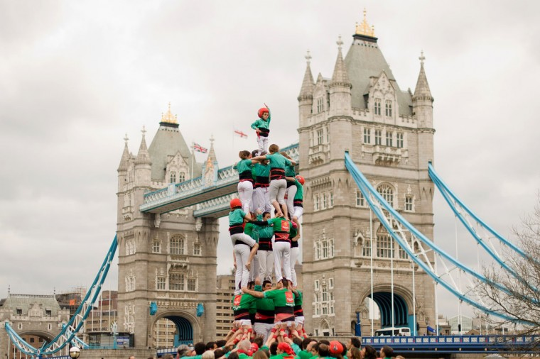 "Members of the ""Castellers de Villafranca"" Human Tower team form a ""castell"" during a promotional event near to Tower Bridge in central London. The Castellers de Villafranca are in London to promote Catalan culture and will be constructing their human towers, a practice that is entered by UNESCO on the list of the Intangible Cultural Heritage of Humanity, in various locations around the capitol. (Leon Neal/AFP/Getty Images)"