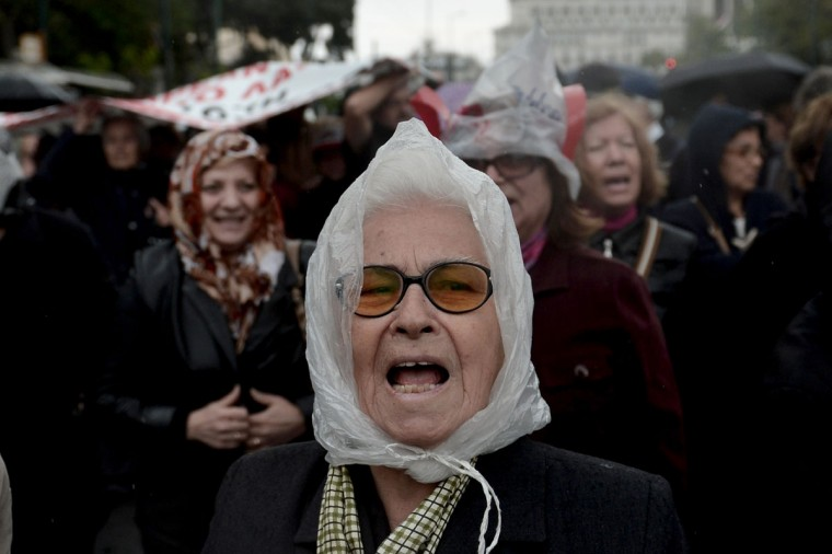 A pensioner shouts a slogan in central Athens during an anti-austerity demonstration. (Aris Messinis/AFP/Getty Images)