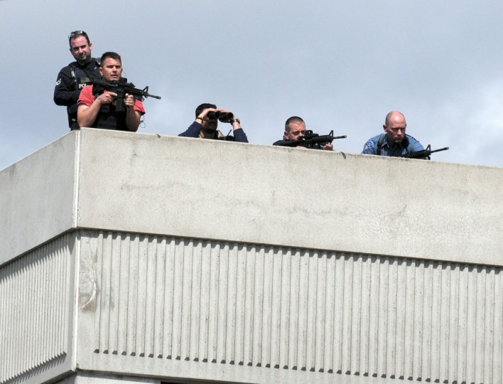 Snipers take positions on a rooftop during the manhunt in Watertown, Massachusetts, for the second suspect in the Boston Marathon bombing who is still at large on April 19, 2013. Thousands of heavily armed police staged an intense manhunt Friday for a Chechen teenager suspected in the Boston marathon bombings with his brother, who was killed in a shootout. Dzhokhar Tsarnaev, 19, defied the massive force after his 26-year-old brother Tamerlan was shot and suffered critical injuries from explosives believed to have been strapped to his body. (John Mottern/AFP/Getty Images)