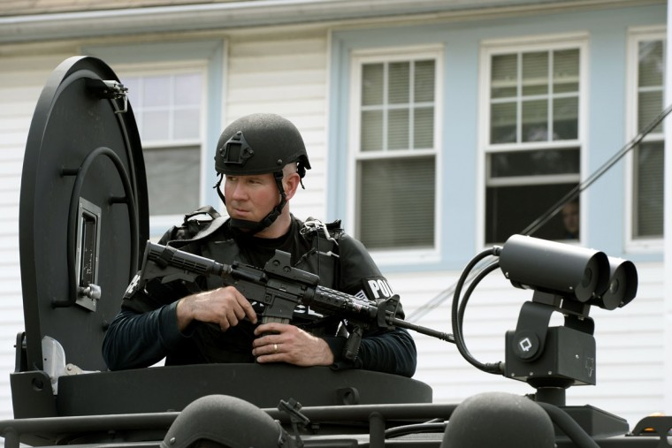 The Cape Cod Police Department SWAT team search houses for the second of two suspects wanted in the Boston Marathon bombings takes place April 19, 2013 in Watertown, Massachusetts. Thousands of heavily armed police staged an intense manhunt Friday for a Chechen teenager suspected in the Boston marathon bombings with his brother, who was killed in a shootout. Dzhokhar Tsarnaev, 19, defied the massive force after his 26-year-old brother Tamerlan was shot and suffered critical injuries from explosives believed to have been strapped to his body. (Timothy A. Clary/AFP/Getty Images)