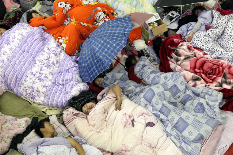 Earthquake victims sleep in a stadium in the city of Ya'an, southwest China's Sichuan province. (STR/AFP/Getty Images)