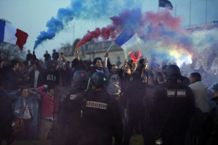 """Protestors face riot gendarmes at the end of a demonstration called """"La Manif Pour Tous"""" (Demonstration for all!) which gathered tens of thousands of opponents of a gay marriage bill on April 21, 2013 in Paris. (Kenzo Tribouillard/AFP/Getty Images)"""