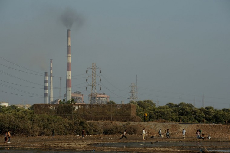 Indian youths play cricket near polluted salt pans near an industrial area in Mumbai. Environmental groups are pushing for stronger forest and wildlife protection and conservation as April 22, 2013 marks World Earth Day. (Puni Paranjpe/AFP/Getty Images)