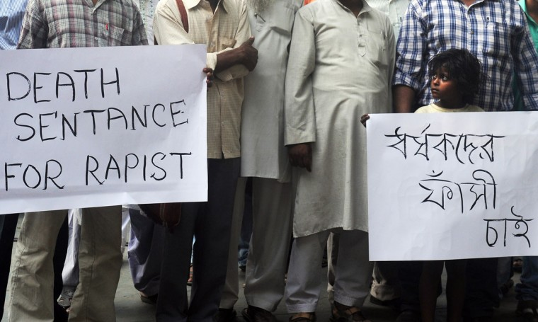 An Indian child poses with a placard as demonstrators take part in a protest against the rape of a five-year old girl, in Kolkata. Indian police arrested a second man over the kidnap and rape of a five-year-old girl in New Delhi, but officers faced protests and a hail of criticism over their insensitive handling of the case. (Dibyangshu Sarkar/AFP/Getty Images)