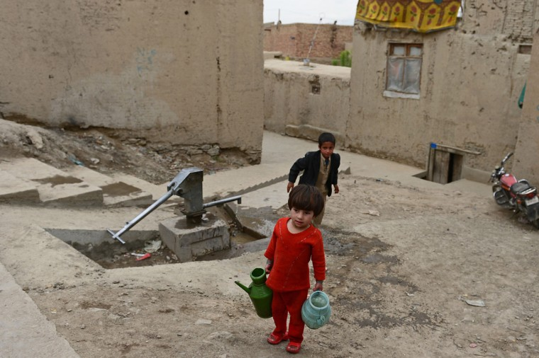 An Afghan child carries water from a well in Kabul during World Earth Day. Environmental groups are pushing for stronger forest and wildlife protection and conservation as April 22, 2013 marks World Earth Day. (Massoud Hossanini/AFP/Getty Images)