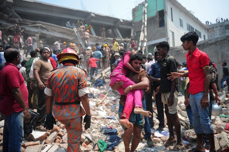 A Bangladeshi volunteer carries an injured garment worker after an eight-storey building collapsed in Savar, on the outskirts of Dhaka, on April 24, 2013. At least 82 people have died and 700 are injured after a eight-storey building housing several garment factories collapsed on the outskirts of Bangladesh's capital on Wednesday, a doctor said. (Munir uz Zaman/AFP/Getty Images)