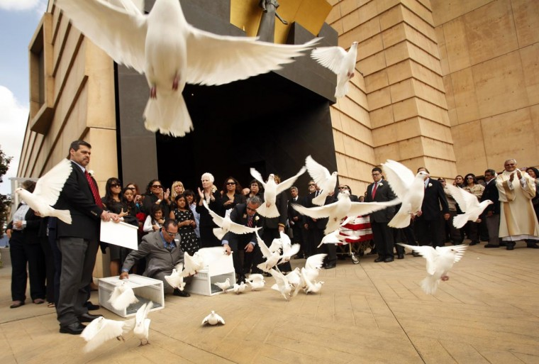 Doves are released by family at the conclusion of the funeral mass for former teacher Sal Castro at the Cathedral of Our Lady of Angels in Los Angeles on Thursday April 25, 2013. Sal Castro was one of the leaders of the 1968 Chicano student walkouts, a protest for better schools that is considered the start of the Chicano movement. (Al Seib/AFP/Getty Images)