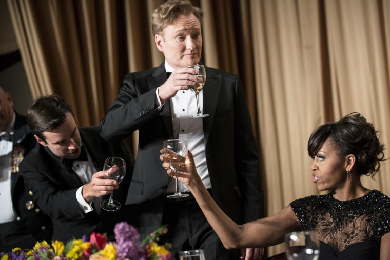 Time Magazine's Michael Scherer (L), Comedian Conan O'Brien (C) and U.S. first lady Michelle Obama raise their glasses with others for a toast during the White House Correspondents' Association Dinner April 27, 2013 in Washington, DC. Obama attended the yearly dinner which is attended by journalists, celebrities and politicians. (Brendan Smialowski/AFP/Getty Images)