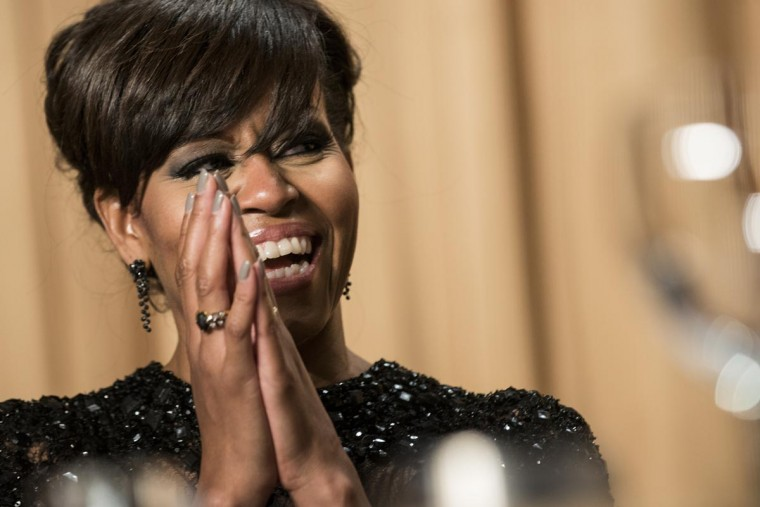 U.S. first lady Michelle Obama laughs during the White House Correspondents' Association Dinner April 27, 2013 in Washington, DC. Obama attended the yearly dinner which is attended by journalists, celebrities and politicians. (Brendan Smialowski/AFP/Getty Images)