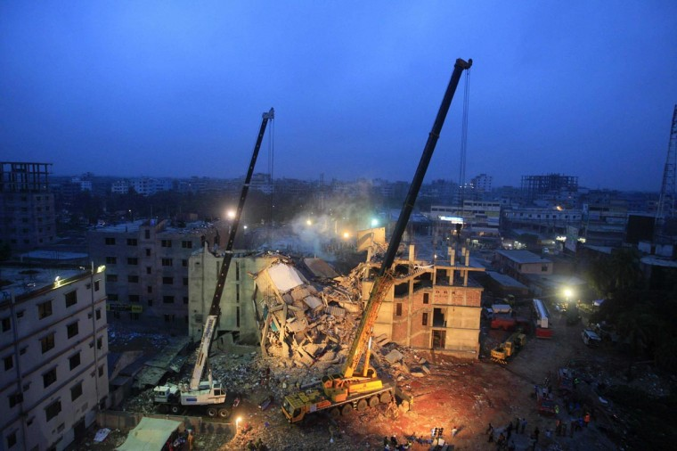 Cranes operated by Bangladeshi Army personnel are pictured at the scene following the April 24 collapse of an eight-storey building in Savar, on the outskirts of Dhaka, on April 29, 2013. Bangladeshi textile bosses pleaded April 29 with Western clothing giants to keep doing business with them after nearly 400 people died as hopes of finding more survivors faded. (Stringer/AFP/Getty Images)
