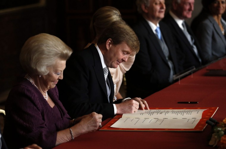 Prince Willem-Alexander of the Netherlands signs the Act of Abdication of The Netherlands' Queen Beatrix during a ceremony held at the Royal Palace in Amsterdam. (Jerry Lampen/Pool/AFP/Getty Images)