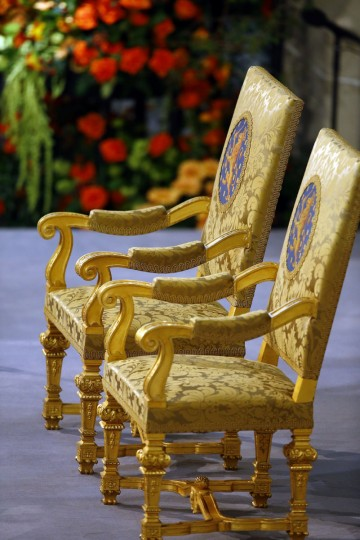 Two royal chairs are set up in the Nieuwe Kerk (New Church) in Amsterdam, The Netherlands, shows the royal chairs at the center of the church during the preparations of the inauguration of King Willem-Alexander. The Netherlands' Willem-Alexander became Europe's youngest monarch on Tuesday after his mother, queen Beatrix, abdicated and his country hailed the avowedly 21st-century king with a massive, orange-hued party. (Michael Kooren/Pool/AFP/Getty Images)
