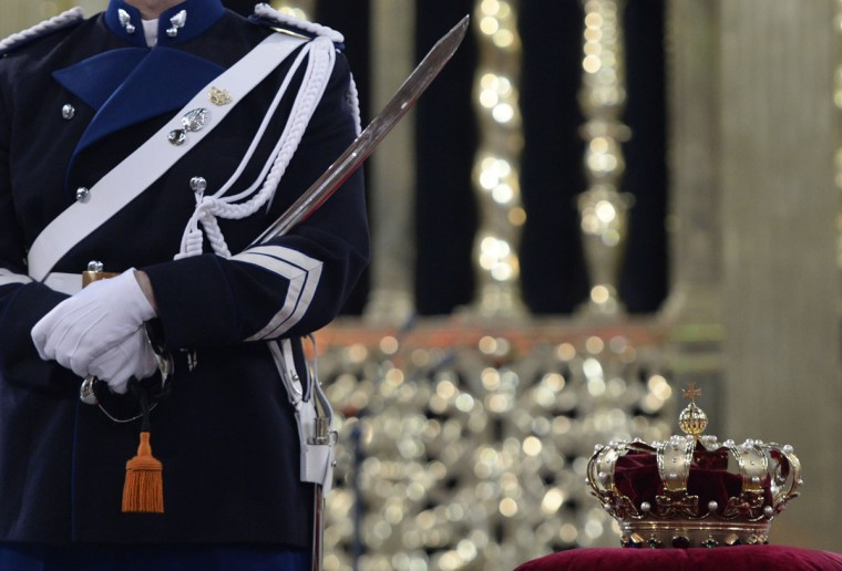 A guard stands guard by the crown laid on a velvet cushion inside the Nieuwe Kerk (New Church) in Amsterdam during the last preparations for the inauguration of King Willem-Alexander of the Netherlands. (Robin Utrecht/Pool/AFP/Getty Images)