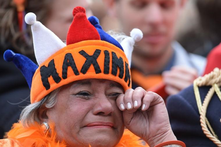 A woman cries during Queen Beatrix of the Netherlands' abdication ceremony as she watches it on a giant screen set up on Dam Square in Amsterdam. (Patrik Stollarz/AFP/Getty Images)