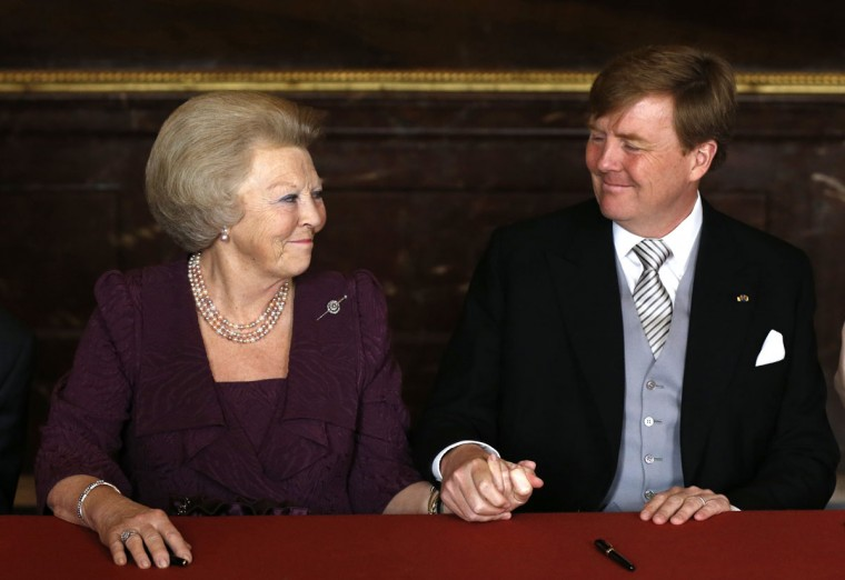 Queen Beatrix of the Netherlands and her son Willem-Alexander attend the abdication ceremony at the Royal Palace in Amsterdam on April 30, 2013. (Bart Maat/AFP/Getty Images)