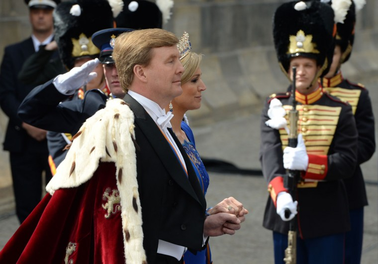 King Willem-Alexander of the Netherlands arrives with his wife Queen Maxima for his inauguration ceremony on April 30, 2013 at Nieuwe Kerk (New Church) in Amsterdam. (Patrik Stollarz/AFP/Getty Images)
