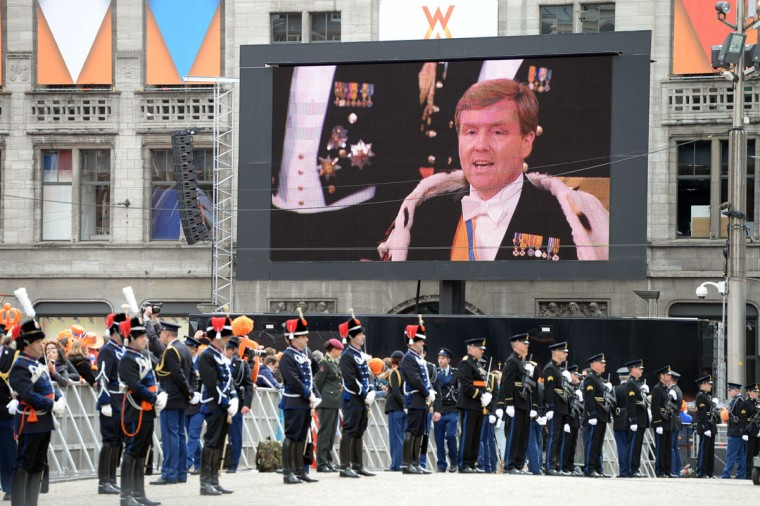 King Willem-Alexander of the Netherlands is seen on a giant screen during his inauguration ceremony on April 30, 2013 at Nieuwe Kerk (New Church) in Amsterdam. (Patrik Stollarz/AFP/Getty Images)