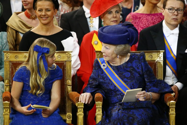 Princess Beatrix of the Netherlands, right, talks with Catharina-Amalia, Princess of Orange as they wait for the start of the inauguration ceremony for King Willem-Alexander of the Netherlands at Nieuwe Kerk (New Church) in Amsterdam. (Michael Kooren/Pool/AFP/Getty Images)