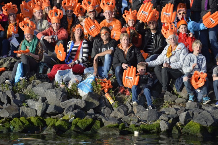Spectators crowd the river banks during the new Dutch King Willem-Alexander and Queen Maxima's boat trip on the IJ river in Amsterdam. (Koen van Weel/AFP/Getty Images)
