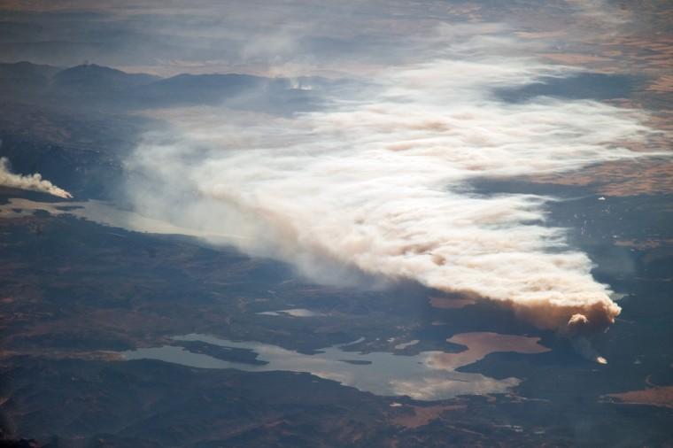 The late summer/fall wildfire season is in full swing in the western United States. Significant wildfires are observed each year by astronauts orbiting the Earth on the International Space Station. This astronaut photograph documents the Arnica Fire in Yellowstone National Park. The fire was started by a lightning strike near Yellowstone Lake on September 13, 2009. By the time it was detected on September 23, 2009, it covered approximately 2 hectares (4 acres). The fire was photographed by the astronauts on the following day (September 24); by then, it had grown to 101 hectares (250 acres) in size. Warm, dry and windy conditions in the area provided a favorable environment for growth of the fire, and as of October 1, 2009, the fire was estimated to be 3,764 hectares (9,300 acres) in size. NASA image