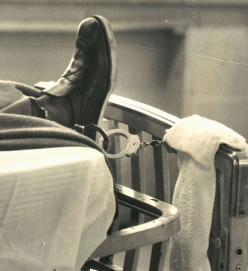 A detainee's leg is shackled to his bed in the city jail in 1976. (William Hotz/ Baltimore Sun)