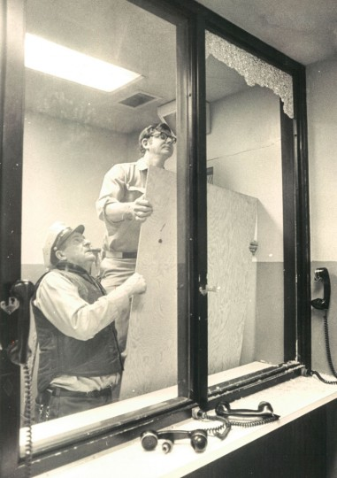 Corrections officers Fred Simms (left) and David Bankeit secure the jail's visitors room in 1972. (Lloyd Pearson/ Baltimore Sun)