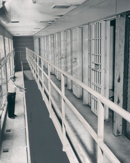 A corrections officer tours a new portion of the Baltimore City jail in 1961. (Baltimore Sun File Photo)