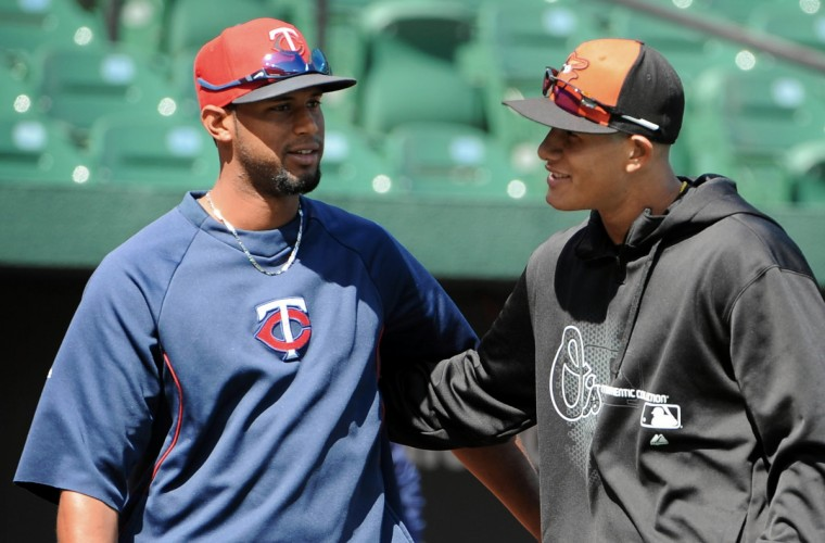 Orioles' Manny Machado, right, greets Twins' Aaron Hicks, left, during batting practice before opening day at Oriole Park at Camden Yards. (Kenneth K. Lam/Baltimore Sun)
