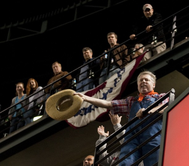 Zill waves a hat from section 244