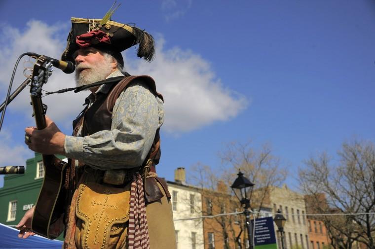 Captain Thomas Flint sings during the 2013 Privateer Festival at Fells Point. (Karl Merton Ferron/Baltimore Sun photo)