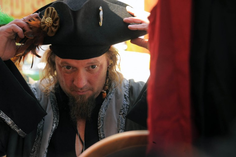 Jimi Schuman of Forest Hill, MD fits a tricorn hat. (Karl Merton Ferron/Baltimore Sun photo)