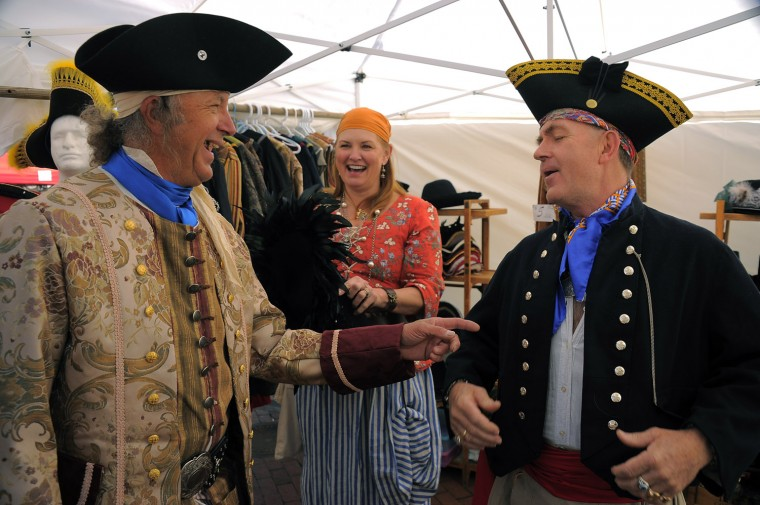 Kate and Peter Gentry of Freeland, Md. try on pirate outfits with Paul Soltis of Harrisburg (left). (Karl Merton Ferron/Baltimore Sun photo)