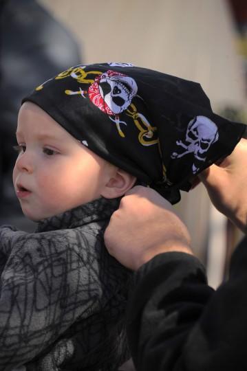 John Laur of Lauraville get a pirate bandana. (Karl Merton Ferron/Baltimore Sun photo)