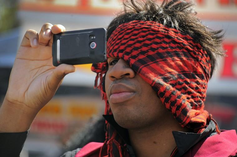 Keenon Reddicks of Baltimore takes a photo during the 2013 Privateer Festival. (Karl Merton Ferron/Baltimore Sun photo)