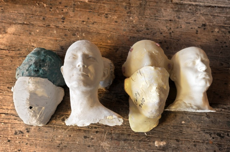 The heads represent some of the steps involved when Artist Lania D'Agostino of D'Agostino Studios makes a life cast figure. The final product at right is a resin head.(Algerina Perna/Baltimore Sun)