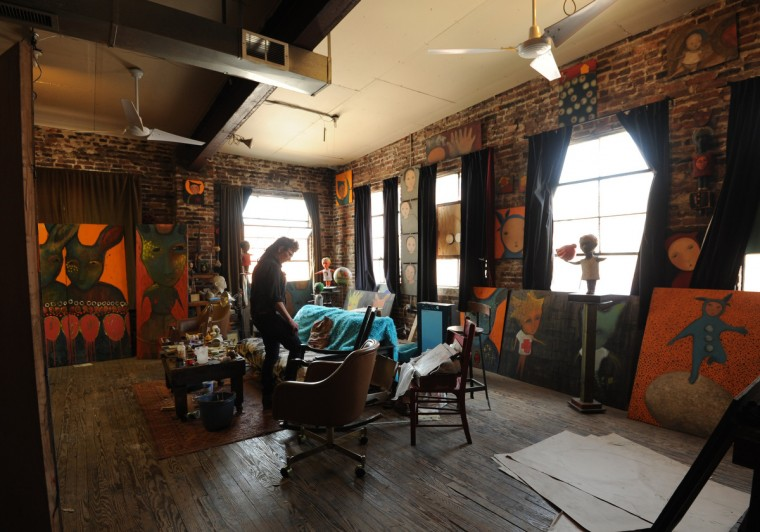 Artist Lania D'Agostino of D'Agostino Studios is pictured in the section of the studio where she paints and draws. She also creates sculpture, lifecast figures and other artwork. (Algerina Perna/Baltimore Sun)
