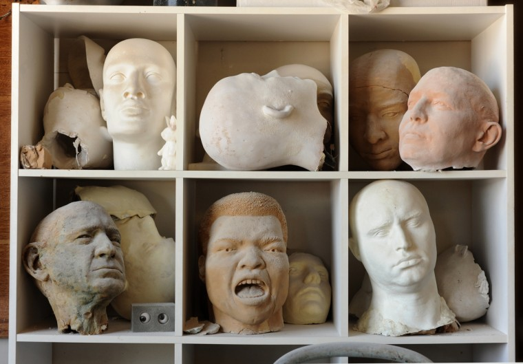 Artist Lania D'Agostino of D'Agostino Studios used a variety of sculpting and casting techniques to create each of the heads pictured in the cubicles. (Algerina Perna/Baltimore Sun)