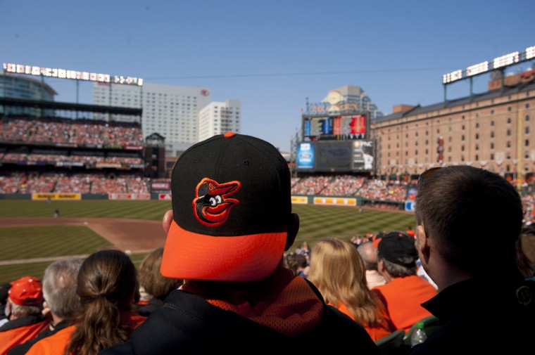 Fans watch the game against the visiting Minnesota Twins at the Baltimore Orioles' home opener at Oriole Park at Camden Yards. (Karl Merton Ferron/Baltimore Sun)