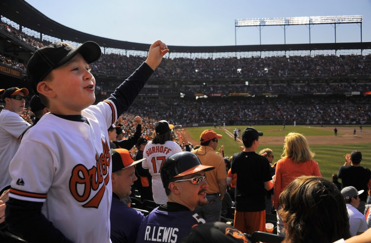 Orioles fan Nate Brzozowski, 9 of White Marsh, celebrates the Orioles taking the lead against the Minnesota Twins at the Baltimore Orioles' home opener at Oriole Park at Camden Yards. (Karl Merton Ferron/Baltimore Sun Staff)