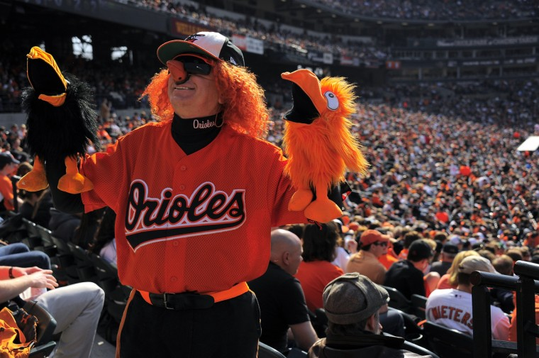 """George """"Birdman"""" Fuhrer of Clearwater Beach is dressed for the occasion at the Baltimore Orioles' home opener at Oriole Park. (Karl Merton Ferron/Baltimore Sun("""