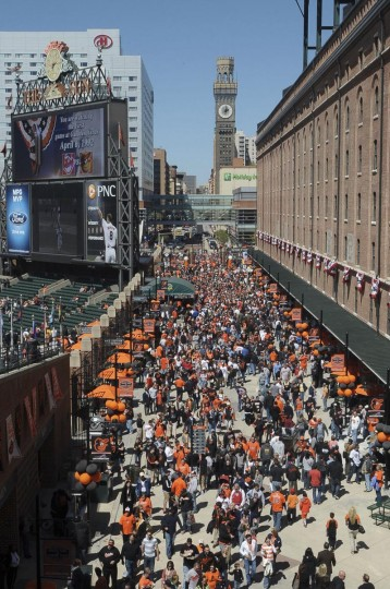2012: Overhead scene of the Eutaw Plaza walkway as the crowds start to file into Camden Yards. Pregame scenes from the 20th opening day at Camden Yards on April 6, 2012. (Gene Sweeney Jr./Baltimore Sun)