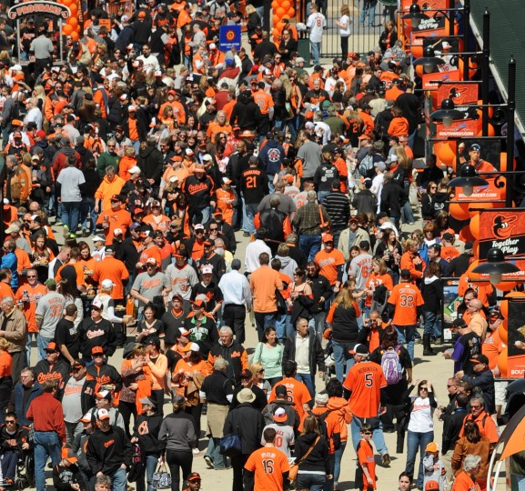 Fans stream into Oriole Park as the gates open for the Orioles home opener. (Jerry Jackson/Baltimore Sun)