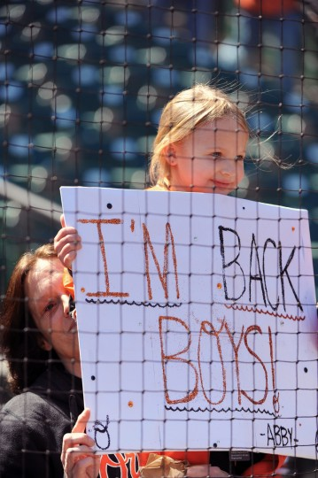 Abby Allman, 5, of Glen Burnie, came to Orioles opening day at Oriole Park at Camden Yards with her sign and grandmother Tina Bednarski, left. (Kenneth K. Lam/Baltimore Sun)