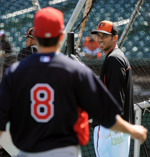 Orioles J.J. Hardy, right, talks with Twins' Jamey Carroll (#8), left, during batting practice before opening day at Oriole Park at Camden Yards. (Kenneth K. Lam/Baltimore Sun)