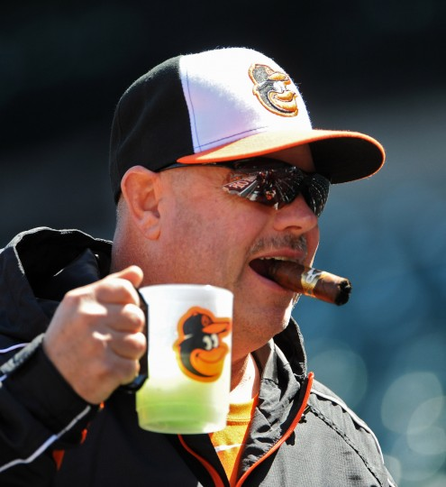 Orioles fan Bradford Bernardo, of Damascus, arrives with a drink and cigar for opening day at Oriole Park at Camden Yards. (Kenneth K. Lam/Baltimore Sun)