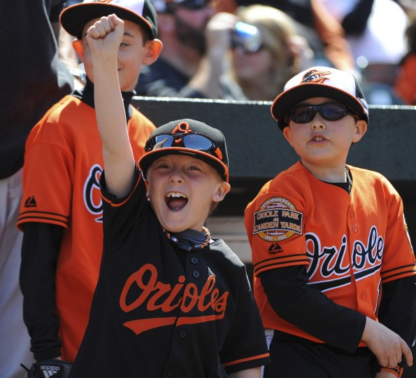 An exuberant fan cheers as the Orioles are introduced on opening day at Oriole Park at Camden Yards. (Kenneth K. Lam/Baltimore Sun)