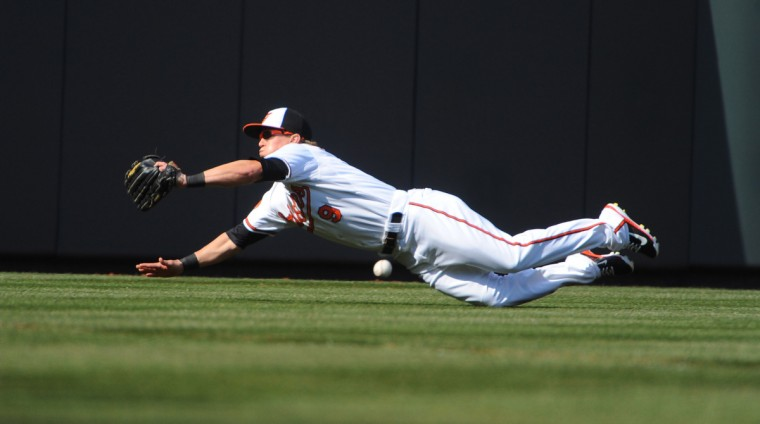 Orioles' Nate McLouth fails to catch a ball hit by Twins' Eduardo Escobar in the 3rd inning. (Kenneth K. Lam/Baltimore Sun)