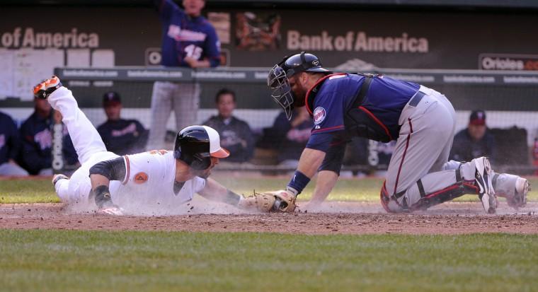 Orioles' Nick Markakis scores on an Adam Jones single in the 5th inning. (Gene Sweeney Jr./Baltimore Sun)