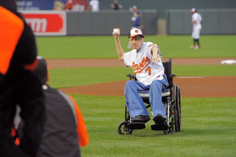 Zill winds up for the ceremonial first pitch